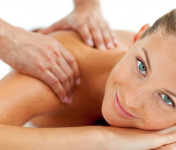 Smiling woman enjoying a massage in a spa center